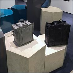 This Balenciaga Purse Hexagonal Pedestal Display proves that circles are just too symmetrical, and squares too plain when it comes to purse display Purse Display, Display Pedestal, Balenciaga Purse, Retail Merchandising, Kiosk, Paper Shopping Bag, Close Up, Things To Come, Purses