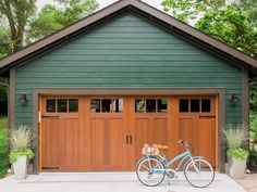 HGTV Urban Oasis 2016 featuring a Clopay Canyon Ridge Collection faux wood carriage house garage door. Mahogany cladding in a Walnut stain. www.clopaydoor.com