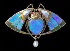 Prof. GEORG KLEEMANN 1863-1932 for THEODOR FAHRNER  Superb Jugendstil Brooch  Gold Plique-à-jour Opal Ruby Pearl  H: 3.3 cm (1.3 in)  W: 4.6 cm (1.81 in). Marks: '18ct' & 'MBCo' for Murrle Bennett & Co. German, c.1902.