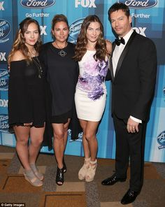 All in the family: Harry Connick Jr., 48, brought along three special dates for the American Idol finale: wife Jill Goodacre, 52, and daughters Charlotte (far left) and Sarah Kate ( far right)