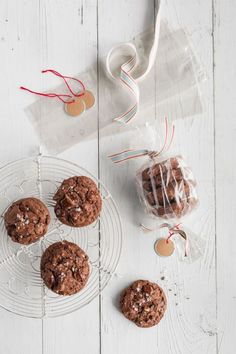 Stack four cookies in a clear plastic bag, then tie decorative ribbon (lemoncatshop.etsy.com) at each end of the bag to cinch. Trim ends and add a metal-rim tag, and you've got yourself a festive hostess gift. Recipe: Triple Chocolate Hazelnut Cookies