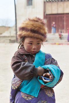 A Tibetan child at the Tibetan Healing Fund (THF) in Lasa, Tibet. This not-for-profit humanitarian organization was established to improve primary healthcare and education for rural Tibetan women and children in the Tibetan regions of P.R. China.