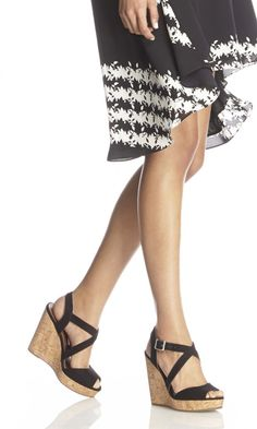 Strappy black platform wedges with a cork heel and peep toe