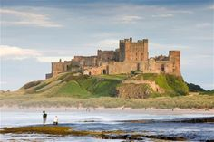Bamburgh, Northumberland Overlooked by Bamburgh Castle, this beautiful stretch of wild coastline offers    clear seas and huge sands that stretch to Seahouses, three miles away. On a    clear day you can see out to Lindisfarne and the Farne Islands.  Stay at St Cuthbert's House (01665 720456; stcuthbertshouse.com ),    an elegant 200-year-old former chapel in North Sunderland near Seahouses.