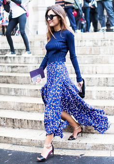 Printed maxi skirt, blue long sleeve, and black heels