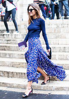 Printed maxi skirt, blue long sleeve, and black heels