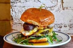 What makes a burger great? Is it the meat? The sauce? The bun? The ability to order it off a secret menu? These are all points of heated debate among food nerds. Local Burger, Burger Restaurant, Good Burger, Chicken Liver Pate, French Restaurants, Secret Menu, Burger Recipes, Food Items, Places To Eat