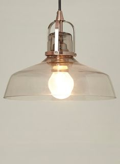BHS // Illuminate // Jed 1 light pendant // lightly smoked gladd shade with copper hardware and a black fabric flex