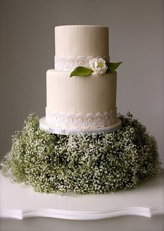 wedding cake – love the hidden pedestal. It would be perfect with a willow tree figurine on top :)