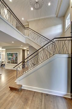 Captivating Design for Modern Home with Stair Railing Ideas: Beautiful Interior Design With Wood Flooring And Stair Railing Ideas Also Foyer Chandelier And Recessed Lighting With Window Molding