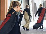 Gwyneth Paltrow loads up her truck before hitting the slopes with Moses 13 in Aspen