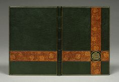 William Minter. Covered in darkgreen Oasis goat skin; grape leaf design from William Morris blind stamped on light orange-brown leather onlays; gold stamped title from die prepared with title page type; gold and blind tooled lines added.