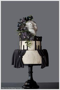 A vintage goth Halloween cake that is dark, eerie and sophisticated. Featuring black sugar flowers and a skull topper. Created by Wild Orchid Baking Company. Bolo Halloween, Halloween Wedding Cakes, Halloween Week, Halloween Cakes, Creepy Halloween, Halloween Treats, Gothic Halloween, Halloween Desserts, Halloween Birthday