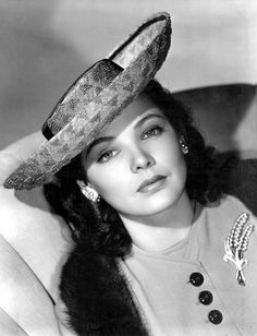 Actress Gene Tierney in a lovely, classic Breton hat. 1940s