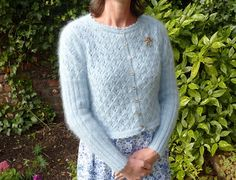 Cropped Cardigan Knitting Patterns : Free knitting pattern for Olivia cardigan – Janet McMahon designed this mohair cardi with ribbed sleeves, an all over eyelet pattern and a crocheted edging. One size, so you'll have to adapt for other sizes. Crochet Cardigan Pattern, Sweater Knitting Patterns, Knitting Designs, Knit Patterns, Knit Cardigan, Cropped Cardigan, Knitting Tutorials, Stitch Patterns, Vintage Knitting