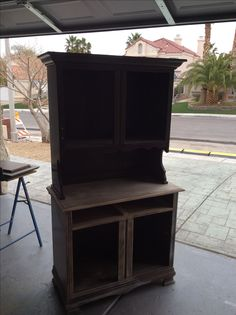 Yugoslavian cabinet, dark finish.  Sanded and prepped for painting