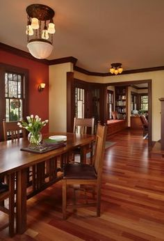 The dining-room lighting fixture is original to the house. The table and chairs were designed and built by Jonathan Pauls to fit comfortably into the Prairie School vocabulary. The living room has new bookcases and built-in seating.
