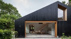 Workshop Architecten has created blackened wood barn for a farm in the Netherlands, which is divided into separate living quarters for sheep and people house architecture, Black wood barn by Workshop Architecten houses livestock and people Contemporary Barn, Modern Barn, Residential Architecture, Modern Architecture, Chinese Architecture, Black Barn, Black Wood, Timber Cladding, Black House