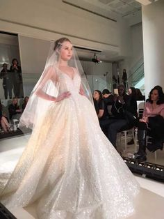 When this Lazaro gown from the Fall 2016 collection debuted on the runway there was an audible gasp from the crowd. With all over shimmer and a full skirt, this ballgown is what wedding fantasies are made of.
