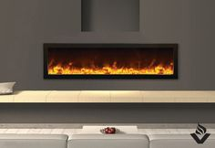 The Amantii BI 60 is a large, linear electric fireplace. It was designed with easy installation in mind, and can be installed virtually anywhere – including outdoors. Other features include heat control, so you can turn the flames on while leaving the heat off, multiple LED colour options, and several media options (unit comes with fire & ice)
