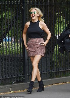 Anyone for tennis? Ellie Goulding showed off her sporty physique in a mini skirt as she arrived at Wimbledon on Wednesday
