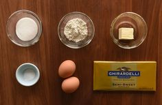 4 ounces semi-sweet baking chocolate2 tablespoons unsalted butter (plus a little more for greasing the custard cups)2 tablespoons sugar (plus a little more for the custard cups)2 large eggs2 tablespoons all-purpose flour1/8 teaspoon kosher salt