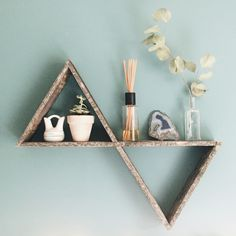 Reclaimed Wood Triangle Shelf! This is a rustic, handcrafted geometric shelf made by my carpenter extraordinaire dad and I!  This shelf is totally unique and one of a kind as it is made from old wooden pallets. I have one hanging in my room and absolutely love it! The possibilities are endless as this shelf works well alone or in a grouping. With multiple triangle shelves of various sizes you can create amazing, functional wall art. Another option is to use on a table to create vignettes.