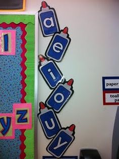 vowel glue bottles hanging up inside classroom Classroom Fun, Classroom Displays, Classroom Organization, Future Classroom, Teaching Tips, Teaching Reading, Creative Teaching, Guided Reading, Creative Writing