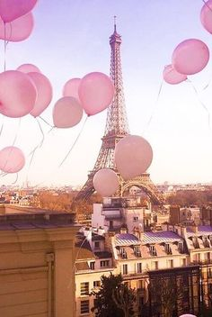 Pink Balloons floating through Pair skies