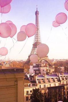 Pink Balloons floating through Pair skies