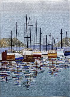 "<p>1st ~ Peaceful Harbor (1126) ~ Marlene Schurr ~ 28""x32"" </p><p>This is my impressionistic view of boats in Puget Sound. It was made mostly from small scraps of fabric quilted with a tulle overlay. It was accepted into The Road to California Quilt Show, January 2013. Machine-appliquéd. Machine-quilted. Original design. </p>"