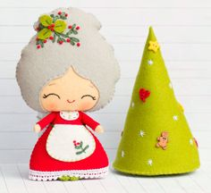 """This PDF sewing pattern is to make a Mrs Santa and a Christmas tree pictured from felt fabrics. These dolls are hand sewn. Size: 7"""" tall"""