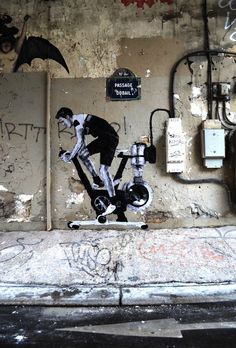 Street artist Charles Leval, aka Levalet, is the mastermind behind these cleverly placed wheat paste characters that interact with the surrounding environments. Located along the streets of Paris, each scene begins as a playful concept sketched on a piece of paper, and then comes to life through Levalet's perfectly arranged black and white drawings combined with the inventive alignment of some simple props.