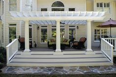 An arbor adds emphasis to the entryway to the deck. This one was built by Peachtree Decks and Porches in Georgia.