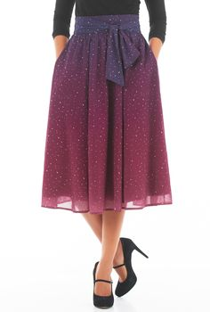 Attached half-ties at the seamed waist beautifully cinches in the wide banded waist of our feminine ombre star print georgette skirt.