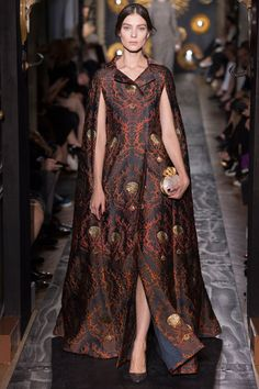 3. Herigaut, Valentino Fall 2013 Couture Collection.  In another Herigaut inspired piece, the excess of sleeve behind the arm are much more dramatic than the previous one noted. In this Valentino contemporary example, pleating details and length differentiate the two.