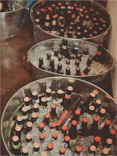 put all the bottles in ice in large containers. Place them on the ground or on a table and everyone will be able to take a bottle and enjoy a fresh drink.