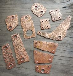 Art Jewelry Elements - After etching, I tube riveted most of the holes (I have an aversion to plain holes in metal components, and I also feel a little more secure using them with linen cording if there's a tube rivet—fewer sharp edges to cut through the cording during the normal wear and tear.)