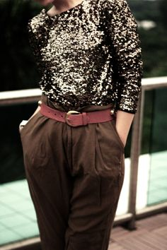 Sequin dipback jumper with brown pants and red belt.