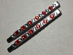 Authentic Swarovski crystal hair clips silver clips w/ crystal and red rhinestones. Super shiny (pictures doesn't do it justice). Start your holiday shopping now. Makes a great present! $8.00/pair.