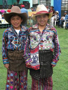 Two students dress in typical Guatemalan traje during a Cooperative for Education school inauguration.
