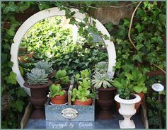 Mirror used as garden window....have just the right spot for this in my back yard.  So so cool!!!