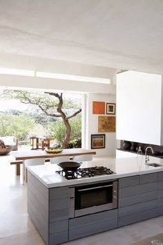 I love this finish on the kitchen cabinets - wonder what exactly it is... An Urban Village: LEON BARNARD'S PERFECT HAVEN IN NAMIBIA
