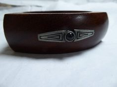Bangle in palisander wood with art deco metal embellishments.