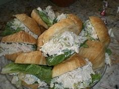 Easy Chicken Salad Sandwich RecipeChicken Salad Recipe --   3 cooked chicken breasts, chopped  1 or 2 stalks celery, chopped  2 green onions, chopped  1/2 cup seedless grapes, halved  3/4 cup dried cranberries  3/4 cup salad dressing  2 Tablespoons coleslaw dressing (Marzetti's is good)  1 teaspoon each- paprika and seasoning salt  Coarsely ground black pepper, to taste