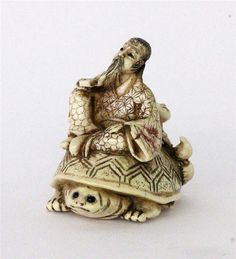 A NETSUKE China / Japan Man and child on turtle