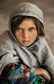 Ghazni; Afghanistan, 1990; AFGHN-12092. Portrait of a girl in a grey headscarf.  Magnum Photos, NYC9261, MCS1991004 K101, Phaidon, Portraits, Looking East, In the Shadow of Mountains, Iconic Images, final book_iconic, final print_milan  In The Shadow of the Mountain_Book Looking East_Book