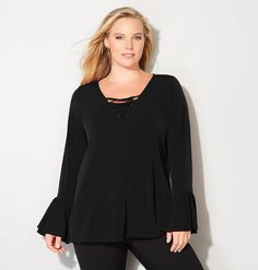 Get a romantic look with the feminine details of this plus size Lace-Up Bell Top available in sizes 14-32 online at avenue.com. Avenue Store