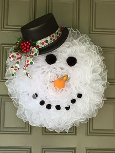 Frosty - large mesh wreath with top hat, Pom Pom eyes and mouth, plastic summer squash nose