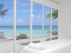 Hunter Douglas Palm Beach™ polysatin shutters with Lantana™ Vinyl Shutters, Window Shutters, Blinds For Windows, Window Blinds, House Shutters, Shutter Blinds, Bedroom Windows, Ceiling Windows, Bathroom Window Treatments
